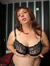 Big titted mature mama playing with her pussy