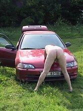 Horny mature slut masturbating in an open field