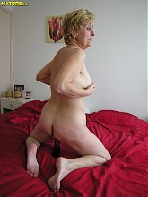 Horny blonde granny playing with a dildo