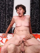Nasty mature Stephanie gets down and dirty and fills her mouth and pussy with a rock hard dong