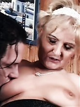 Stocking clad blonde granny Ursula got herself a fuck buddy and takes in his dong in her mouth and pussy